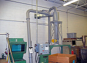Cyclone separator collects plastic grinding dust.