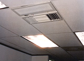 Above-ceiling air cleaner removes odor from break room.