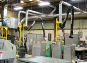 Extractor arms collect galvanized welding fumes.