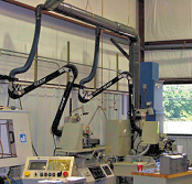 Extractor arms collect oil mist /smoke from machining.