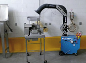 Portable dust collector collects dust from food sifter.