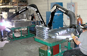 Dual arm portable air cleaner collects welding smoke.
