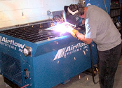 Downdraft table collects welding smoke.