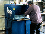 Downdraft table removes steel dust.