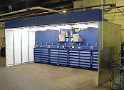 Containment booth for fiberglass dust.