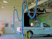 Vehicle exhaust hose drops for a motor pool repair facility.