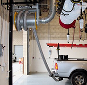 Hose reel for exhaust removal from city vehicle repair shop.